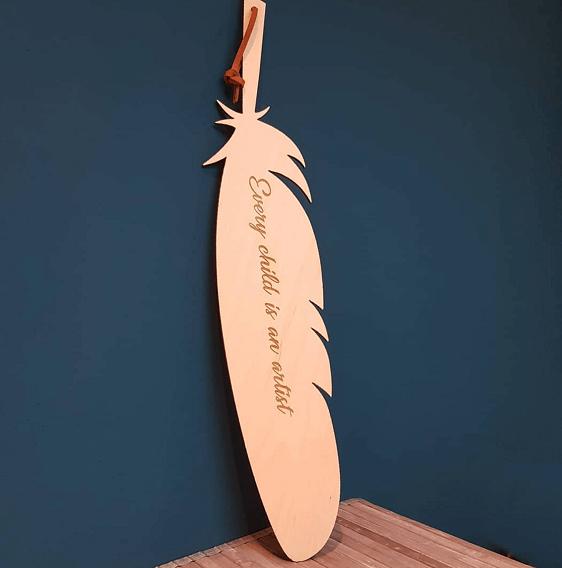 houten veer met tekst